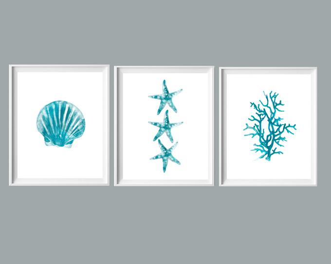 three framed blue wall art